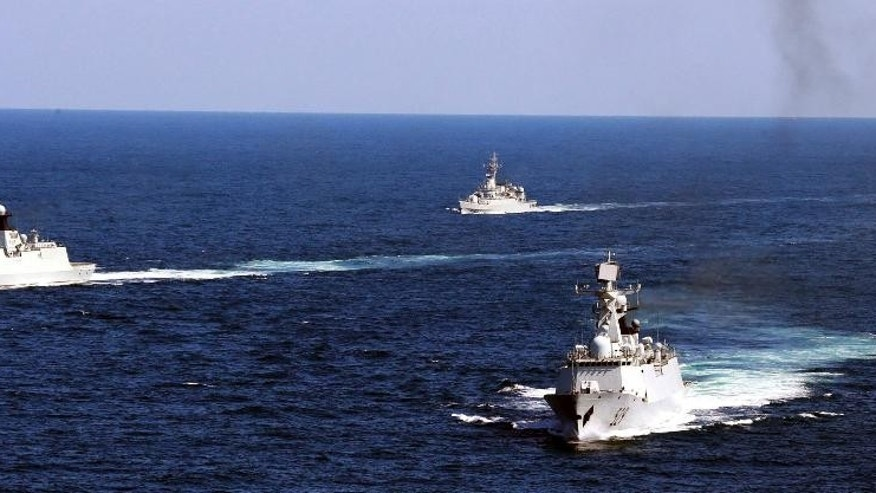FILE - In this Oct. 19, 2012 file photo, Chinese navy vessels take part in a drill in the waters off Zhoushan in east China's Zhejiang province. Despite pressure from Washington and elsewhere, China appears determined to avoid granting any hint of legitimacy to the U.N. abitration tribunal that might challenge its claim to ownership of virtually the entire South China Sea, including its islands, reefs, fish stocks and potentially rich reserves of oil and gas. (AP Photo/File) CHINA OUT