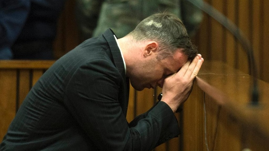 Oscar Pistorius appears in the High Court in Pretoria, South Africa, Tuesday, June 14, 2016 on the second day of the double-amputee runner's sentencing hearing for murdering girlfriend Reeva Steenkamp. An appeals court found Pistorius guilty of murder and not culpable homicide for the shooting death Steenkamp. (AP Photo/Deaan Vivier, Pool via AP)
