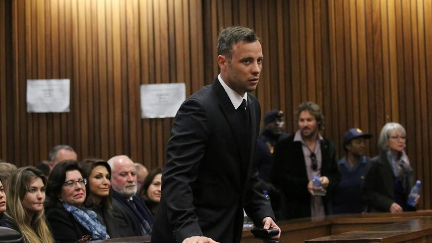 Oscar Pistorius appears in the High Court in Pretoria, South Africa, Wednesday, June 15, 2016 on the third day of the double-amputee runner's sentencing hearing for murdering girlfriend Reeva Steenkamp. Kim Martin, a cousin of Steenkamp has testified in a South African court at the sentencing hearing for Pistorius, who was convicted of murdering his girlfriend in his home in 2013.  (AP Photo/Siphiwe Sibeko, Pool)
