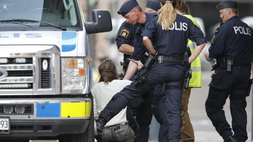 Swedish police arrest people  suspected of assaulting security guards and trespassing at the government headquarters in Stockholm Wednesday June 15, 2016. Swedish news agency TT says the four people arrested were environmental activists planning a stunt as part of a campaign urging the government to close state-owned utility Vattenfall's coal operations in Germany.  (Christine Olsson TT via AP) SWEDEN OUT