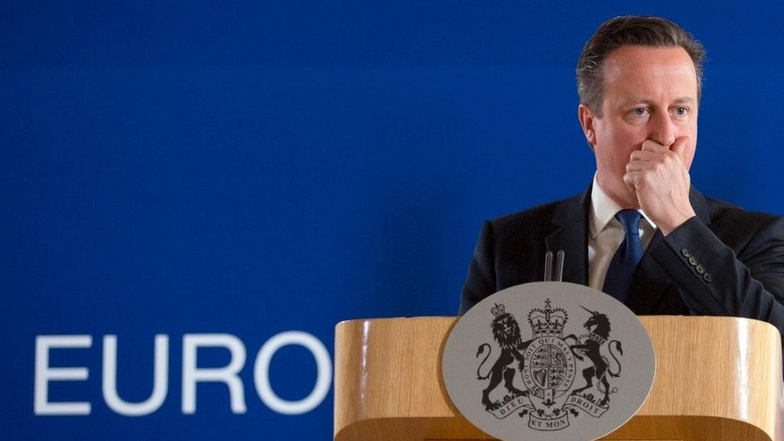 WITH STORY BRITAIN EU FUTURE - In this Friday, June 26, 2015 file photo, British Prime Minister David Cameron pauses before speaking during a media conference at an EU summit in Brussels.  Opinion polls suggest a vote could go either way on June 23, 2016 when Britain chooses whether to leave the 28-nation bloc it joined in 1973. (AP Photo/Virginia Mayo, File)