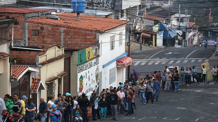 SAN CRISTOBAL, VENEZUELA - MARCH 08:  A long que of people queue up before sunrise to buy basic foodstuffs at a supermarket on March 8, 2014 in San Cristobal, the capital of Tachira state, Venezuela. Shortage of such products as flour, milk and sugar have made life increasingly difficult for residents of Tachira, which has been a focal point for anti-government protests for almost a month.  (Photo by John Moore/Getty Images)