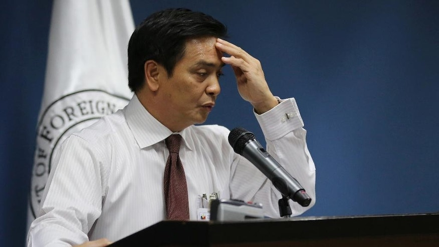 Philippine Foreign Affairs spokesperson Charles Jose touches his forehead as he answers questions from reporters in suburban Pasay, south of Manila, Philippines on Thursday, June 16, 2016. Jose answered questions from reporters, who asked why Association of Southeast Asian Nations foreign ministers were unable to issue a joint statement about the territorial disputes in the South China Sea which could have offended China after a Beijing-hosted meeting in the southern Chinese city of Yuxi. (AP Photo/Aaron Favila)