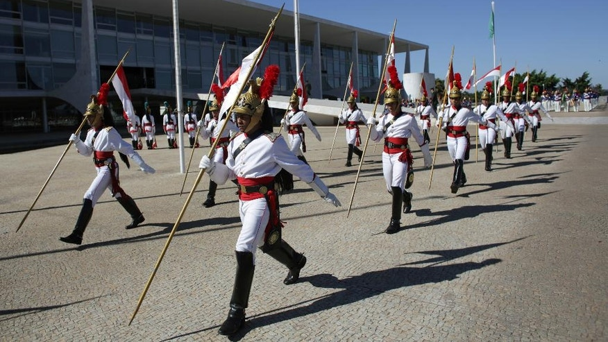 Brazilian soldiers take part in the changing of the guard on the ramp that leads to Planalto presidential palace in Brasilia, Brazil, Thursday, June 16, 2016. The upper house will make the final vote on suspended President Dilma Rousseff's impeachment trial in the coming months. (AP Photo/Eraldo Peres)