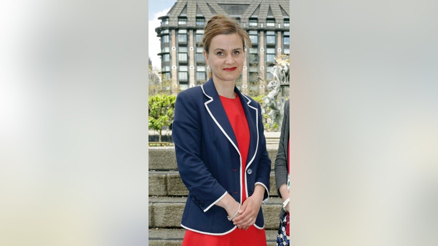 FILE  In this May 12, 2015 file photo, Labour Member of Parliament Jo Cox poses for a photograph. British lawmaker Cox has been injured in a shooting incident near Leeds, in West Yorkshire, England, it has been reported, Thursday June 16, 2016. (Yui Mok/PA via AP, File) UNITED KINGDOM OUT