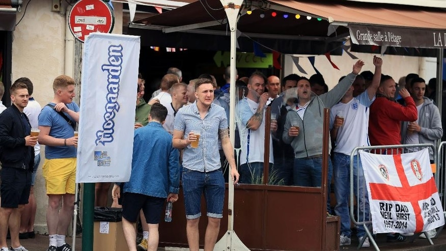 England soccer team supports drink in a bar in Lens; France Thursday June 16, 2016 ahead of England's Euro 2016 group B clash with Wales. (Mike Egerton/PA via AP) UNITED KINGDOM OUT  NO SALES NO ARCHIVE