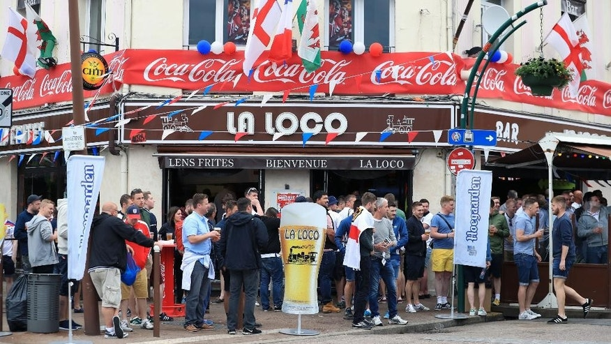 England soccer team supports drink in a bar in Lens, France Thursday June 16, 2016 ahead of England's Euro 2016 group B clash with Wales. (Mike Egerton/PA via AP) UNITED KINGDOM OUT  NO SALES NO ARCHIVE