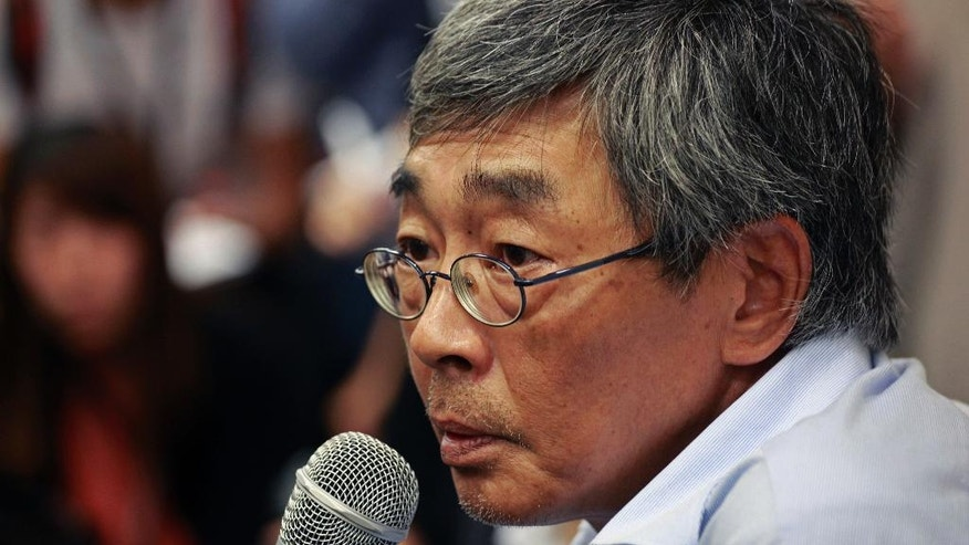 Freed Hong Kong bookseller Lam Wing-kee listens to reporter's questions during a news conference in Hong Kong Thursday, June 16, 2016. Lam detailed his experience in custody in mainland China during his months long disappearance that has raised concern in Hong Kong that mainland authorities are undermining the territory's autonomy and rule of law. (AP Photo/Vincent Yu)