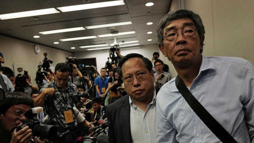 Freed Hong Kong bookseller Lam Wing-kee, right, is accompanied by pro-democracy lawyer Albert Ho after giving a news conference in Hong Kong Thursday, June 16, 2016. Lam detailed his experience in custody in mainland China during his months long disappearance that has raised concern in Hong Kong that mainland authorities are undermining the territory's autonomy and rule of law. (AP Photo/Vincent Yu)