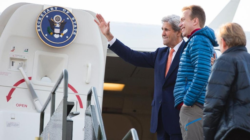 U.S. Secretary of State John Kerry, left, stands with Norway's Foreign Minister Borge Brende as he boards his plane for a trip to view the Blomstrand Glacier, and areas impacted by climate change in Norway's extreme north, Thursday, June 16, 2016, in Oslo. (AP Photo/Evan Vucci, Pool)