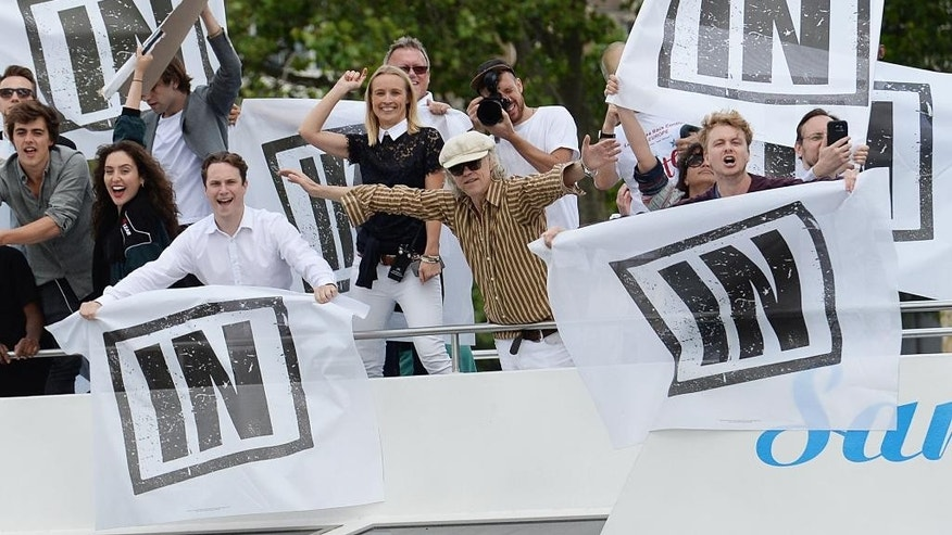 """Irish singer Bob Geldof, center, gestures on board a boat taking part in a pro-EU counter demonstration, as a Fishing for Leave pro-Brexit """"flotilla"""" makes its way along the River Thames in London, Wednesday, June 15, 2016. (Stefan Rousseau/PA via AP) UNITED KINGDOM OUT"""