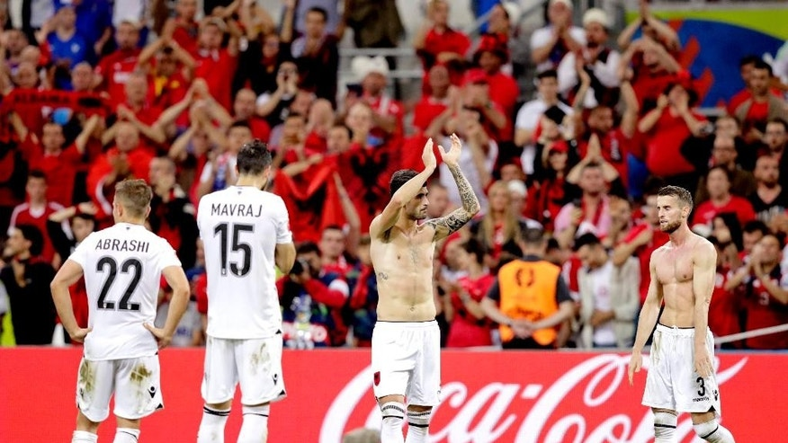 Albanian players salute fans at the end of the Euro 2016 Group A soccer match between France and Albania at the Velodrome stadium in Marseille, France, Wednesday, June 15, 2016. (AP Photo/Ariel Schalit)