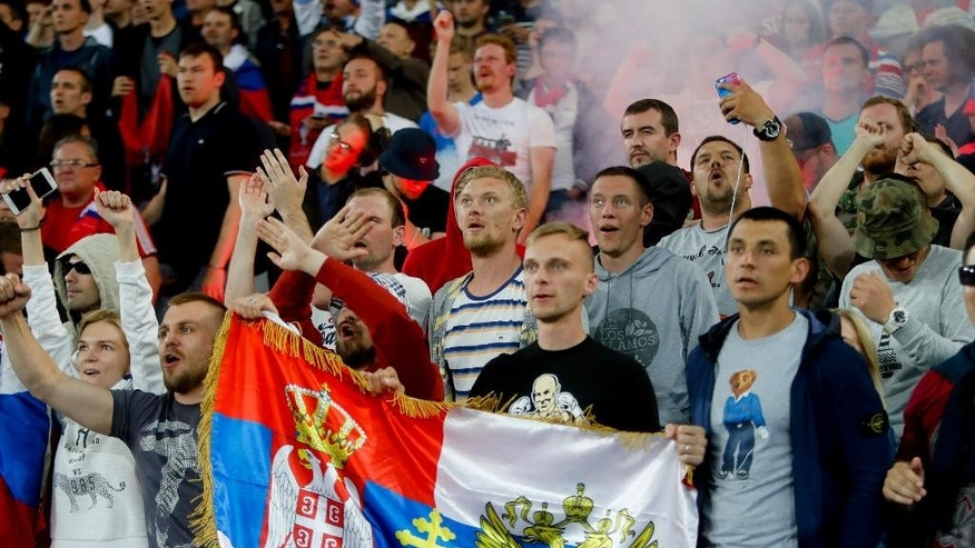 Russian fans watch the Euro 2016 Group B soccer match between Russia and Slovakia at the Pierre Mauroy stadium in Villeneuve d'Ascq, near Lille, France, Wednesday, June 15, 2016. Slovakia won 2-1. (AP Photo/Michel Spingler)