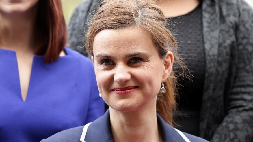 In this May 12, 2015 photo, Labour Member of Parliament Jo Cox poses for a photograph. Britain's Press Association says Labour lawmaker Jo Cox has been injured in a shooting near Leeds, England, it has been reported, Thursday June 16, 2016. (Yui Mok/PA via AP, File) UNITED KINGDOM OUT