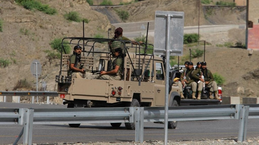 Pakistan army troops patrol near the Torkham border post between Pakistan and Afghanistan, Wednesday, June 15, 2016. Renewed clashes overnight at a Pakistani-Afghan border crossing killed an Afghan border guard and wounded five, an Afghan official said Wednesday, as Islamabad dispatched more troops to the volatile boundary amid an escalation between the two neighbors. (AP Photo/Mohammad Sajjad)