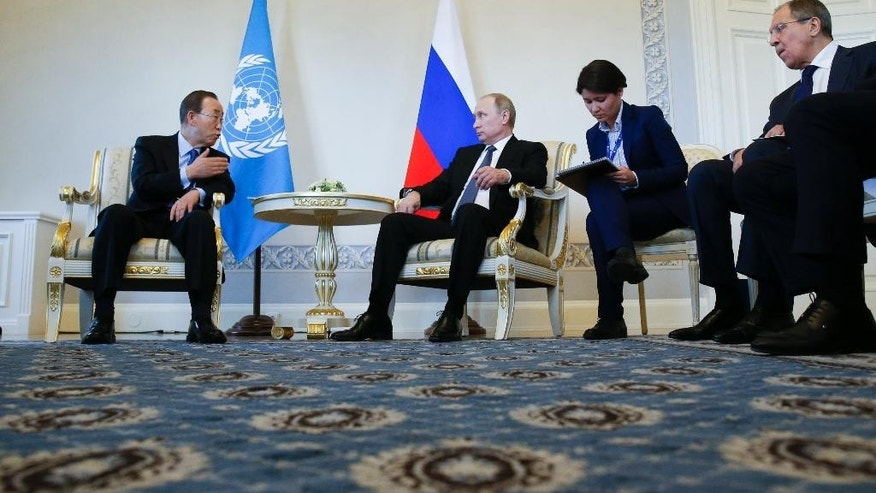 Russian President Vladimir Putin, second left, meets with U.N. Secretary General Ban Ki-moon at the St. Petersburg International Economic Forum in St. Petersburg, Russia, Thursday, June 16, 2016. At right is Russian Foreign Minister Sergey Lavrov. (AP Photo/Dmitry Lovetsky)