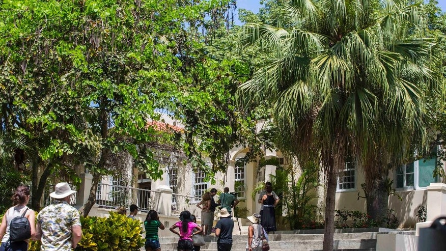 Tourists visit Finca Vigia, home of U.S. writer Ernest Hemingway in Havana, Cuba, Wednesday, June 15, 2016. The home fell into disrepair over a half-century of Cold War between the U.S. and Cuba, which suffers under both a U.S. trade embargo and the self-imposed problems of an inefficient and unproductive centrally planned economy. (AP Photo/Desmond Boylan)