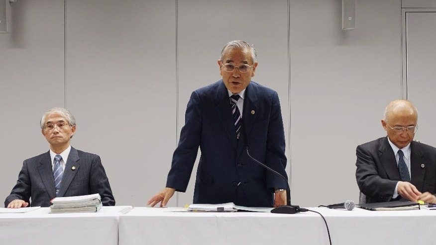 """Yasuhisa Tanaka, center, chairman of an outside investigation team appointed by the operator of Japan's damaged Fukushima nuclear plant, speaks during a press conference in Tokyo Thursday, June 16, 2016. The team has concluded that an instruction from then-company president to avoid mentioning """"meltdown"""" delayed disclosure of the status of three reactors. Tokyo Electric Power Co. described the Fukushima reactors' condition as less serious """"core damage"""" for two months after the March 2011 earthquake and tsunami wrecked the plant. Two other lawyers of the team are: Zenzo Sasaki, left, and Toshiki Nagasaki. (AP Photo/Mari Yamaguchi)"""