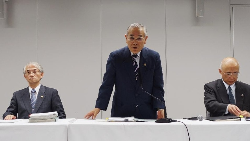 "Yasuhisa Tanaka, center, chairman of an outside investigation team appointed by the operator of Japan's damaged Fukushima nuclear plant, speaks during a press conference in Tokyo Thursday, June 16, 2016. The team has concluded that an instruction from then-company president to avoid mentioning ""meltdown"" delayed disclosure of the status of three reactors. Tokyo Electric Power Co. described the Fukushima reactors' condition as less serious ""core damage"" for two months after the March 2011 earthquake and tsunami wrecked the plant. Two other lawyers of the team are: Zenzo Sasaki, left, and Toshiki Nagasaki. (AP Photo/Mari Yamaguchi)"
