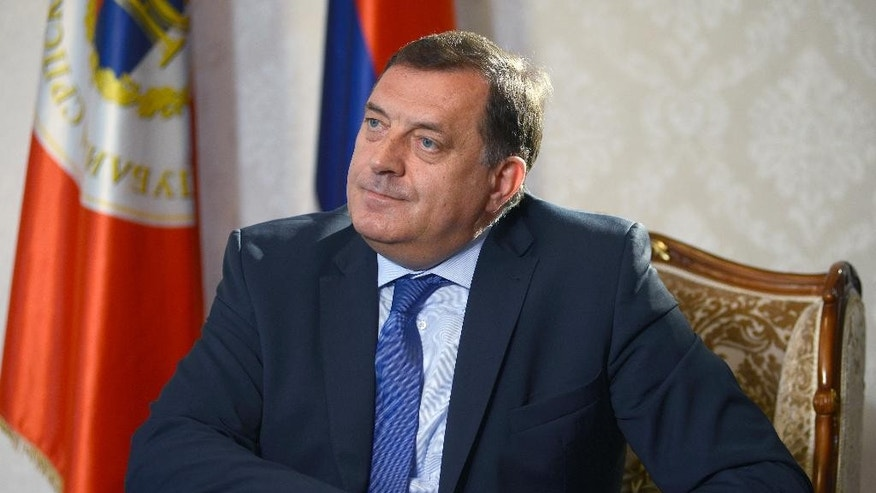"In this photo taken on Tuesday, June 14, 2016 President of the Republic of Srpska Milorad Dodik listens to a question during an interview to the AP in Banja Luka, Bosnia. Western diplomats have urged Bosnian leaders to consider joining NATO, saying it could bring security and improve people's lives. But a Bosnian Serb leader Milorad Dodik said ""Serbs will not let Bosnia join until the alliance resolves its differences with Russia"". (AP Photo/Radivoje Pavicic)"