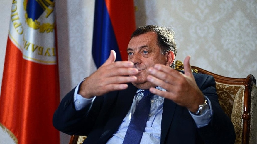 "In this photo taken on Tuesday, June 14, 2016 President of the Republic of Srpska Milorad Dodik gesture during an interview to the AP in Banja Luka, Bosnia. Western diplomats have urged Bosnian leaders to consider joining NATO, saying it could bring security and improve people's lives. But a Bosnian Serb leader Milorad Dodik said ""Serbs will not let Bosnia join until the alliance resolves its differences with Russia"". (AP Photo/Radivoje Pavicic)"