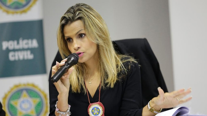 Police investigator Cristiana Bento speaks during a press conference in Rio de Janeiro, Brazil, Friday, June 17, 2016. The police officer investigating the gang rape of a 16-year-old girl that made international headlines because videos showing men posing with the unconscious victim were shared on social media says she's asking charges be brought against seven men. (AP Photo/Silvia Izquierdo)
