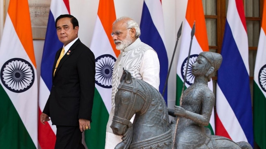 Indian Prime Minister Narendra Modi, right, and Thailand's Prime Minister Prayuth Chan-ocha walk down for a meeting in New Delhi, India, Friday, June 17, 2016.(AP Photo/Saurabh Das)