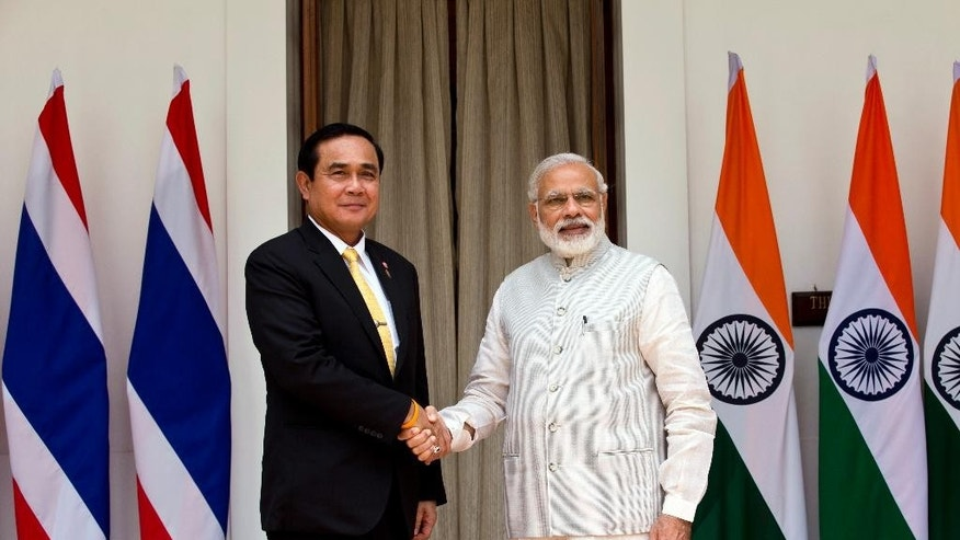 Indian Prime Minister Narendra Modi, right, and Thailand's Prime Minister Prayuth Chan-ocha pose for the media before a meeting in New Delhi, India, Friday, June 17, 2016. (AP Photo/Saurabh Das)