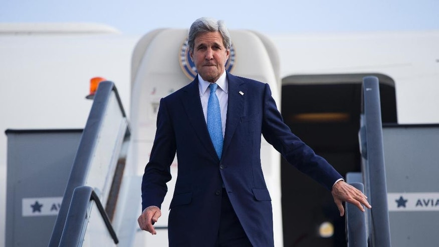 US Secretary of State John Kerry steps off his plane after arriving at Kastrup International Airport, Thursday, June 16, 2016, in Copenhagen. (AP Photo/Evan Vucci, Pool)