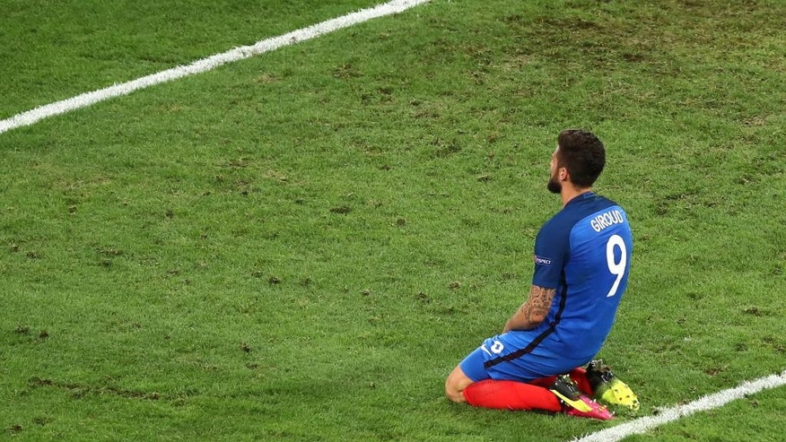 France's Olivier Giroud sits on the pitch during the Euro 2016 Group A soccer match between France and Albania at the Velodrome stadium in Marseille, France, Wednesday, June 15, 2016. (AP Photo/Claude Paris)