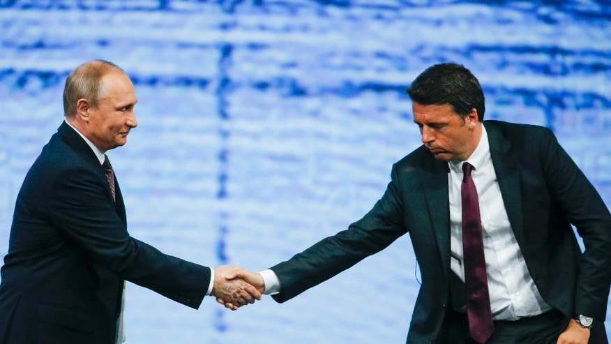 Russian President Vladimir Putin, left, and  Italian Premier Matteo Renzi shake hands during a meeting at the St. Petersburg International Economic Forum in St. Petersburg, Russia, Friday, June 17, 2016. (AP Photo/Dmitry Lovetsky)