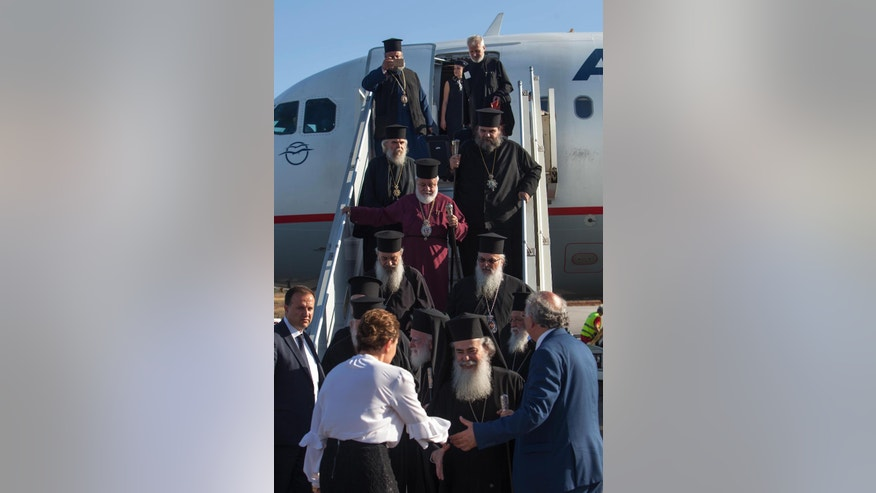 In this Thursday, June 16, 2016 photo released by Holy and Great Council, Patriarch of Jerusalem Theophilos, front, arrives with other Patriarchs at the airport of Chania in the Greek island of Crete to take part the Orthodox Synod starting Sunday. The Holy and Great Council, was to become the first meeting of all Orthodox leaders since the year 787. The meeting is still on, but with the Russian Orthodox Church and three other churches staying away its pan-Orthodox aura has faded.       (Holy and Great Council via AP)