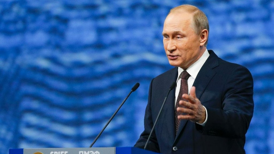 Russian President Vladimir Putin gestures as he addresses the St. Petersburg International Economic Forum in St.Petersburg, Russia, Friday, June 17, 2016. (AP Photo/Dmitry Lovetsky)