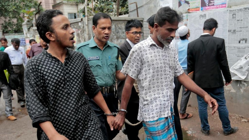 FILE- In this June 13, 2016, file photo, Bangladeshi men detained as part of crackdown on extremists are escorted by policemen in Dhaka, Bangladesh. A crackdown on Islamist militants and crime in Bangladesh has drawn international criticism after thousands accused only of petty crimes are jailed. Rights groups and analysts say the government may be trying to prove too much, too fast, in its fight against violent Islamists, while the opposition accuses it of staging the law enforcement raids to stomp out political dissent. (AP Photo, File)