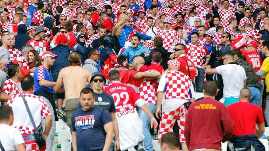 Croatia's team fans run in the stands after flares were thrown onto the pitch during the Euro 2016 Group D soccer match between the Czech Republic and Croatia at the Geoffroy Guichard stadium in Saint-Etienne, France, Friday, June 17, 2016. (AP Photo/Darko Bandic)