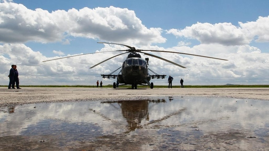 A Russian Mi-8 helicopter before flying to the landing area of the Soyuz TMA-19M spacecraft carrying International Space Station (ISS) crew members, Tim Peake of Britain, Yuri Malenchenko of Russia and Tim Kopra of the U.S., at the airport of Karaganda, Kazakhstan, Saturday, June 18, 2016. (AP Photo/Shamil Zhumatov, pool)