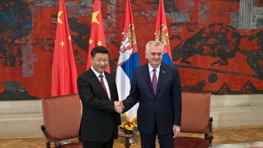 Chinese President Xi Jinping, left, and his Serbian counterpart, Tomislav Nikolic, shake hands at the start of their meeting in Belgrade, Serbia, Saturday, June 18, 2016. Xi arrived in Serbia for a visit meant to boost relations with the friendly nation and assert China's intention to increase its presence in the Balkans and Europe. (AP Photo/Marko Drobnjakovic)
