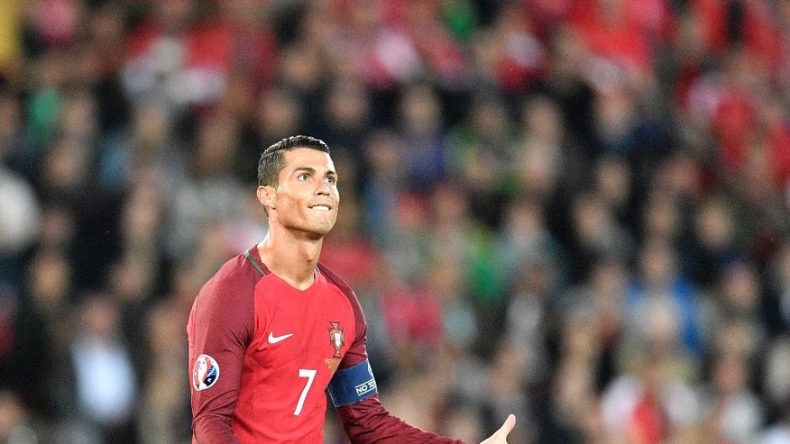 Portugal's Cristiano Ronaldo gestures during the Euro 2016 Group F soccer match between Portugal and Austria at the Parc des Princes stadium in Paris, France, Saturday, June 18, 2016. (AP Photo/Martin Meissner)