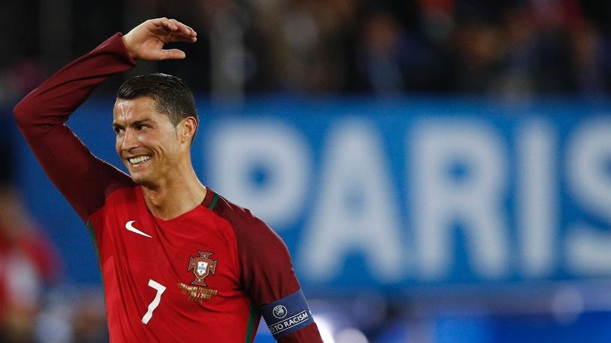 Portugal's Cristiano Ronaldo reacts during the Euro 2016 Group F soccer match between Portugal and Austria at the Parc des Princes stadium in Paris, France, Saturday, June 18, 2016. (AP Photo/Christophe Ena)