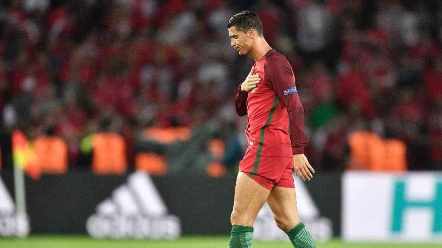 Portugal's Cristiano Ronaldo gestures to the supporters at the end of the Euro 2016 Group F soccer match between Portugal and Austria at the Parc des Princes stadium in Paris, France, Saturday, June 18, 2016. (AP Photo/Martin Meissner)