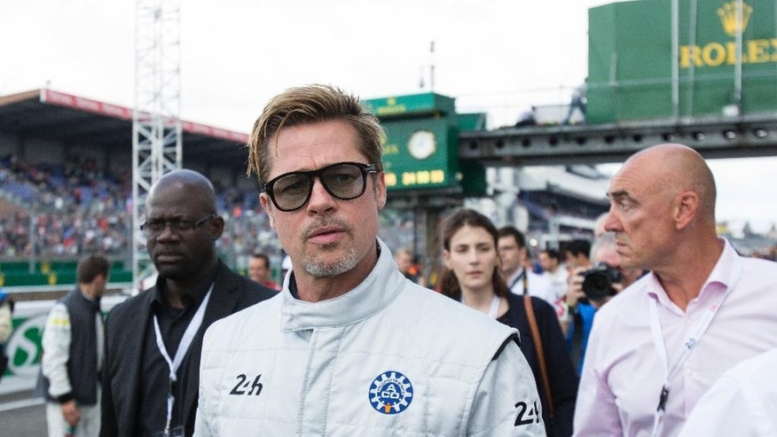 Actor Brad Pitt arrives to start the 84th 24-hour Le Mans endurance race, in Le Mans, western France, Saturday, June 18, 2016. (AP Photo/Kamil Zihnioglu)