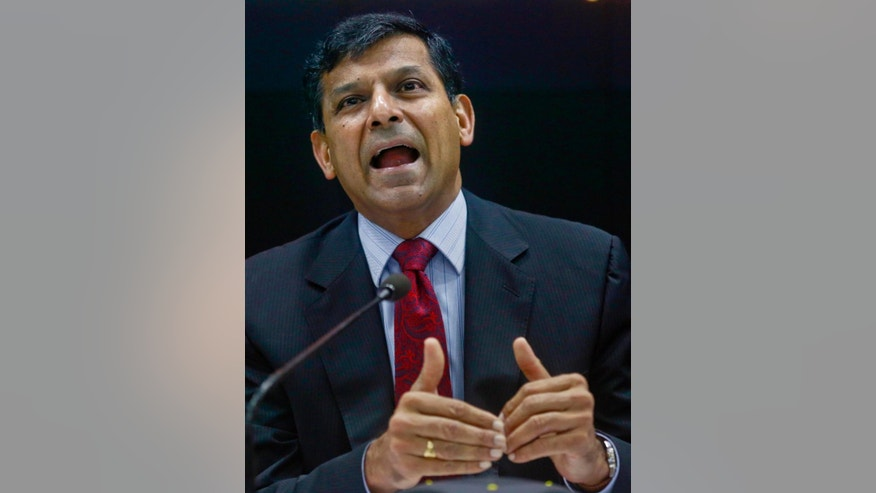 FILE- In this April 5, 2016 file photo, Reserve Bank of India (RBI) Governor Raghuram Rajan addresses a press conference in Mumbai, India. Rajan issued a statement on Saturday, June 18, 2016 saying that he'll quit and return to academia when his term ends in September. (AP Photo/Rafiq Maqbool, File)