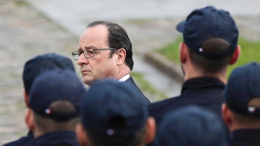 French President Francois Hollande attends a ceremony for  the two police officials killed by an extremist claiming allegiance to IS,   Friday, June 17, 2016 in Versailles, near Paris. Police commander Jean-Baptiste Salvaing and his companion, police administrator Jessica Schneider were stabbed Monday by attacker Larossi Abballa, who was killed in a police raid. (AP Photo/Kamil Zihnioglu)