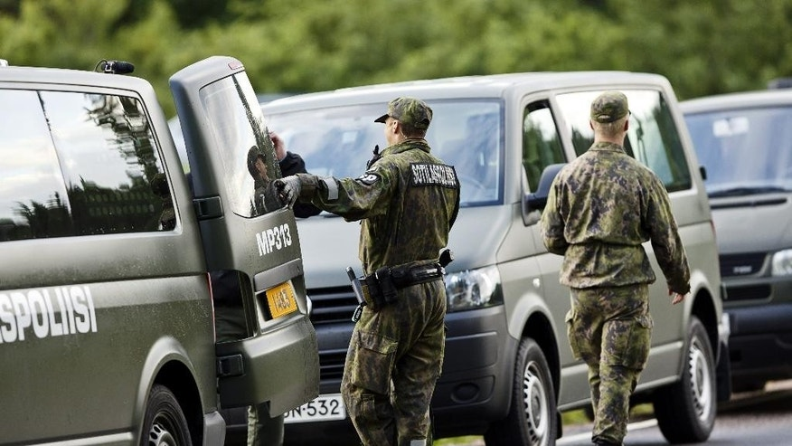 Military police officers attend the scene of a deadly shooting in Vihti, Finland Saturday, June 18, 2016. Authorities in Finland say a shooter has killed a police officer and seriously wounded another after they approached a remote countryside property where gunfire had been reported. (Roni Rekomaa/Lehtikuva via AP) FINLAND OUT