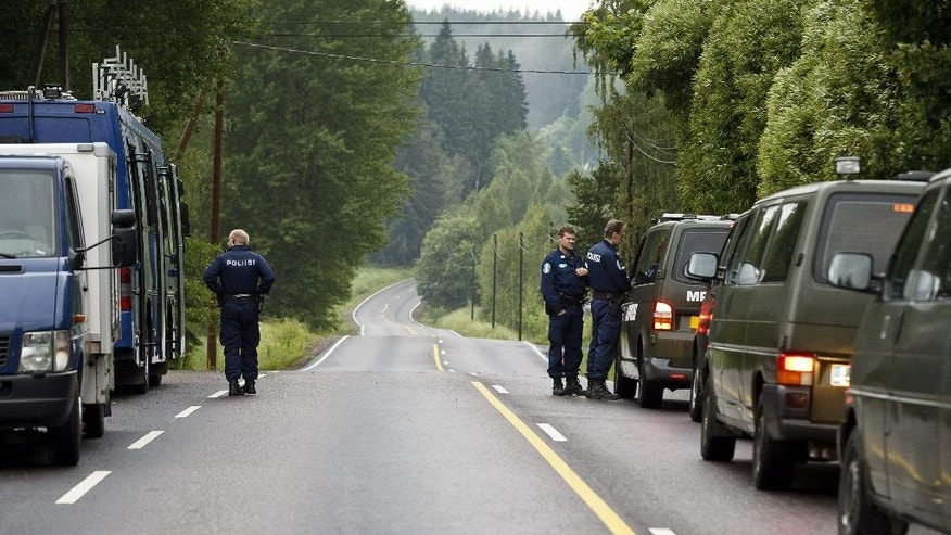Police officers attend the scene of a deadly shooting of a deadly shooting in Vihti, Finland Saturday, June 18, 2016. Authorities in Finland say a shooter has killed a police officer and seriously wounded another after they approached a remote countryside property where gunfire had been reported. (Roni Rekomaa/Lehtikuva via AP) FINLAND OUT