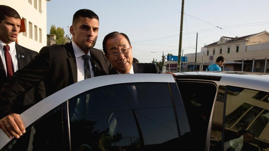 Ban Ki-moon, escorted by police guards leaves the Solidarity Now group offices, which helps victims of Greece's financial crisis and migrants stuck in the country, in Athens, on Friday, June 17, 2016. The United Nations secretary-general is visiting a charity in Athens, ahead of talks with Greek government officials and a trip to the island of Lesbos, which is at the forefront of Greece's immigration crisis. (AP Photo/Petros Giannakouris)