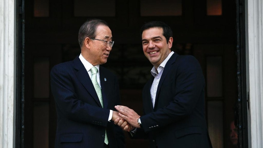 U.N. Secretary General Ban Ki-moon, left, is welcomed by Greek Prime Minister Alexis Tsipras in Athens, on Saturday, June 18, 2016. The United Nations secretary-general is visiting a charity in Athens, ahead of talks with Greek government officials and a trip to the island of Lesbos, which is at the forefront of Greece's immigration crisis. (AP Photo/Yorgos Karahalis)