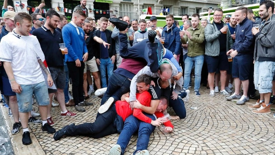 England supporters entertain themselves in Saint-Etienne, France, Sunday, June 19, 2016, one day ahead of the Euro 2016 Group B soccer match against Slovakia. (AP Photo/Darko Bandic)