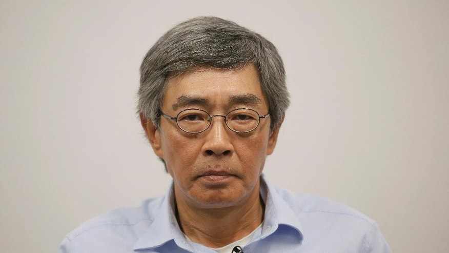 Hong Kong bookseller Lam Wing-kee listens to a reporter's question during an interview in Hong Kong, Sunday, June 19, 2016. The Hong Kong bookseller whose disappearance sparked international concern says he was so despondent during his detention by authorities in mainland China that he considered suicide. In an interview Sunday, Lam told The Associated Press that he thought about using his clothes to hang himself but couldn't find a way to do it in the small room where he was kept under constant watch for five months. (AP Photo/Vincent Yu)