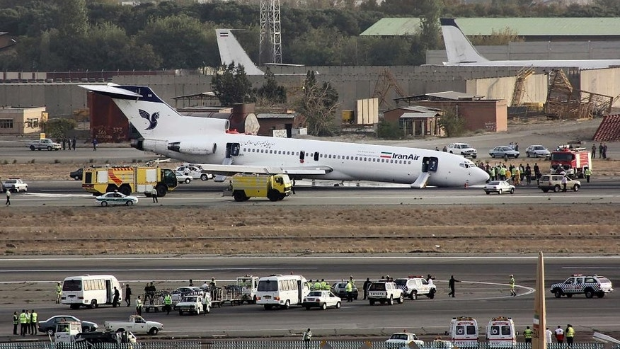 FILE- In this Tuesday, Oct. 18, 2011 FILE photo, an Iran Air Boeing 727 landed on its nose, after the landing gear jammed, at the Mehrabad airport in Tehran, Iran. Boeing Co. is negotiating a deal to sell 100 airplanes to Iran, state-run media reported Sunday, June 19, 2016 a sale potentially worth billions that would mark the first major entry of an American company into the Islamic Republic after last year's nuclear deal. (AP Photo/Hamid Reza Jafari, File)